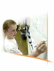 boy working on an equation at the board